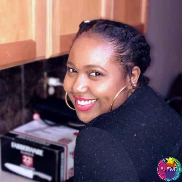 A young black woman with black hair and a black shirt.