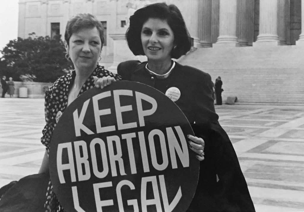 Roe and her lawyer fighting to keep abortion legal.
