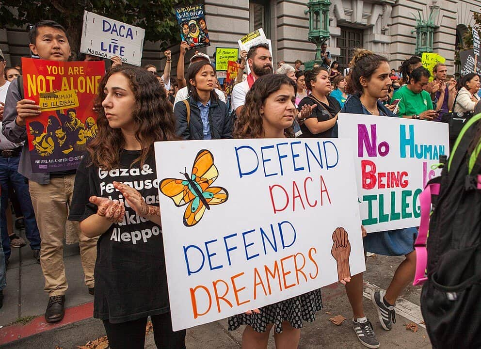DACA protesters hold signs promoting immigration reform San Francisco