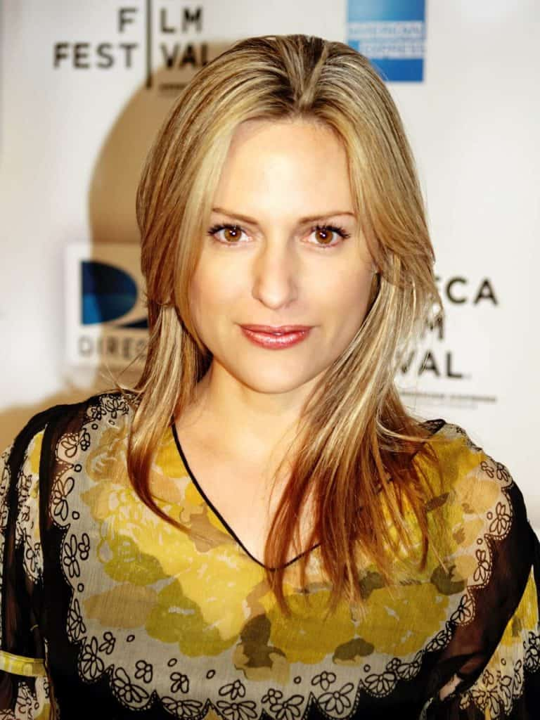 Aimee Mullins at the 2009 Tribeca Film Festival wearing a yellow dress.