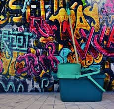 Dennis Bonifas promotes suicide prevention by making a difference in his community by abolishing racist graffitti by cleaning it up.
