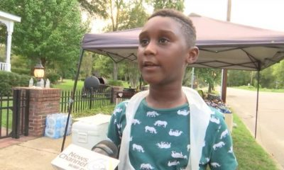 6 year old African American boy, Bell, helps Hurricane Dorian people out by selling hot dogs.