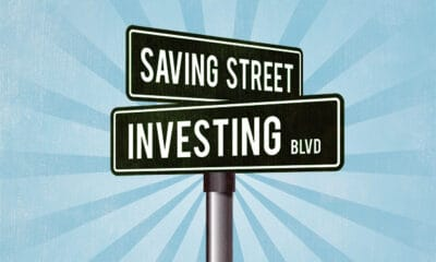 A street sign with the words SAVING STREET and INVESTING BLVD in white text in black boxes.