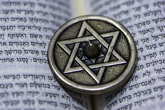 Star of David laid on top of an open Torah