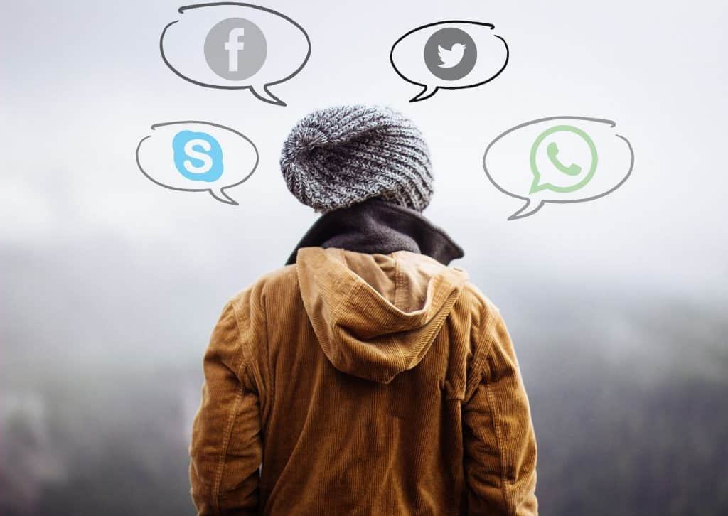 A college student with the logos of Skype, Facebook, Twitter, WhatsApp around their head