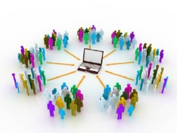 Nine groups of animated people, each with a variation of colors ,and with arrows connecting to one laptop in the middle.