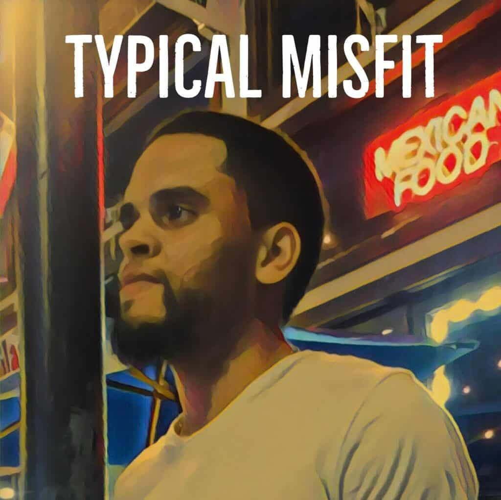 An animated picture of a dark haired young man with a beard and wearing a beige shirt in front of a Mexican restaurant.