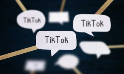7 speech bubbles that read TikTok on a blue and gold striped background.