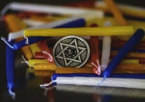 Star of David surrounded by Hanukkah candles