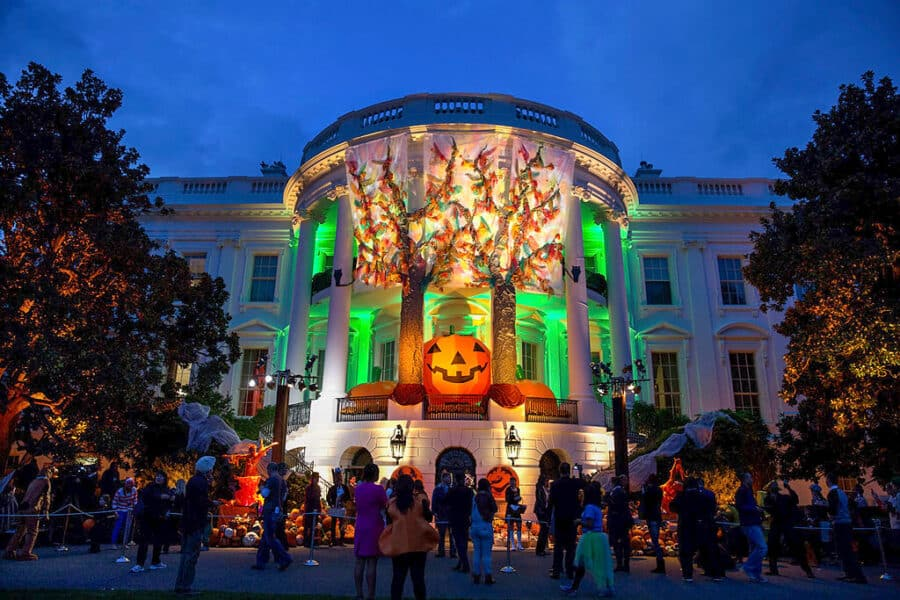 The back of the White House with Halloween decorations and a big pumpkin.