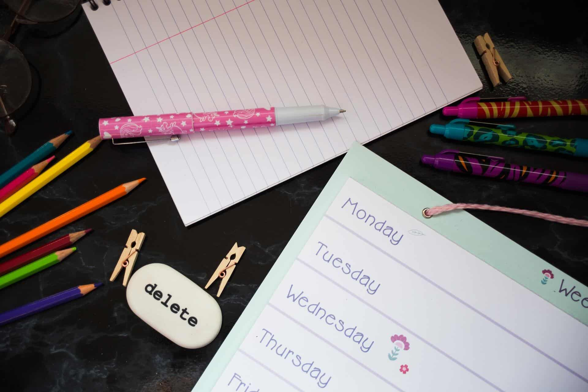 A college planner with pens and paper