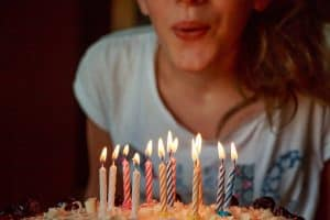 A girl blowing out birthday candles