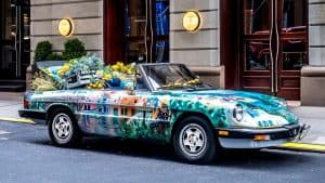 A decorated car with flowers