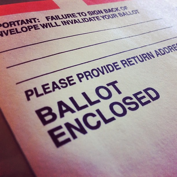 Close-up of an official election ballot, with a ballot enclosed