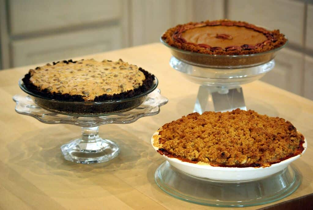 Three thanksgiving pies in a small table.