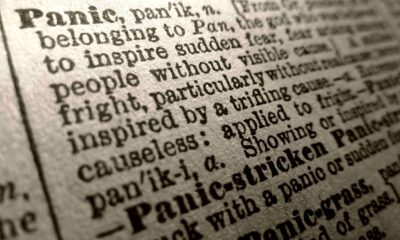 Close up of the dictionary definition of panic - to inspire sudden fear