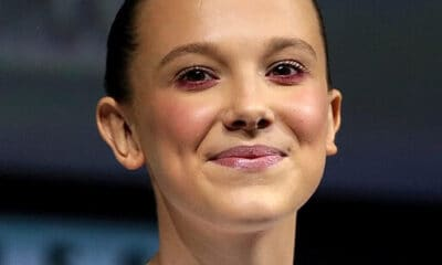 Millie Bobbie Brown, star of Enola Holmes, smiling and looking into the camera