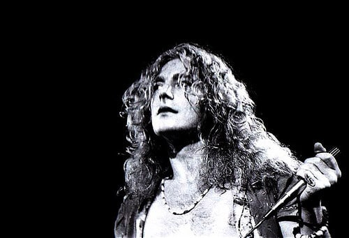 Robert Plant, of Led Zeppelin standing on stage as he performs