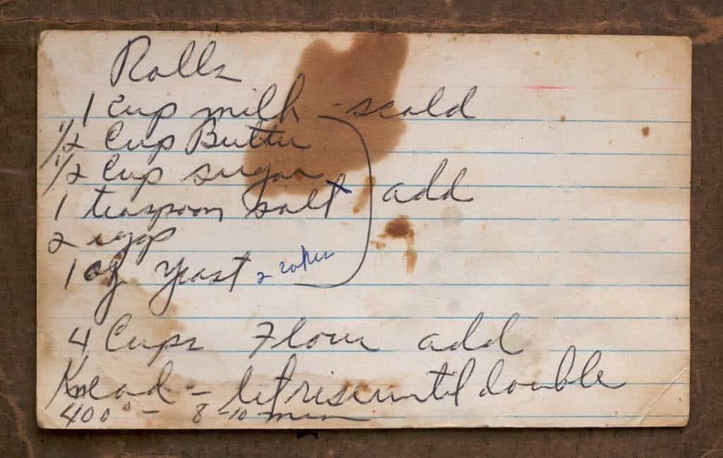 An old recipe for rolls, on a stained lined paper, a recipe that has been in the family for years and modified over time.
