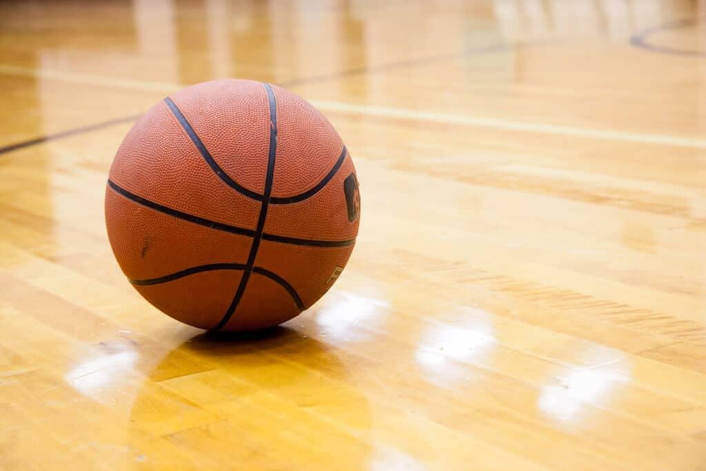 A basketball on an indoor basketball court.