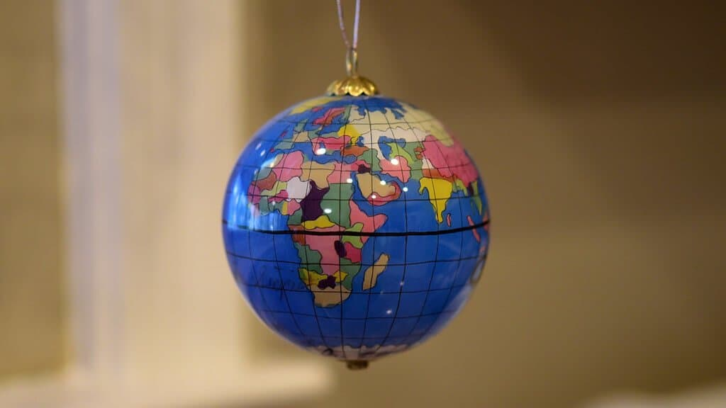 A tree ornament in the form of a globe.