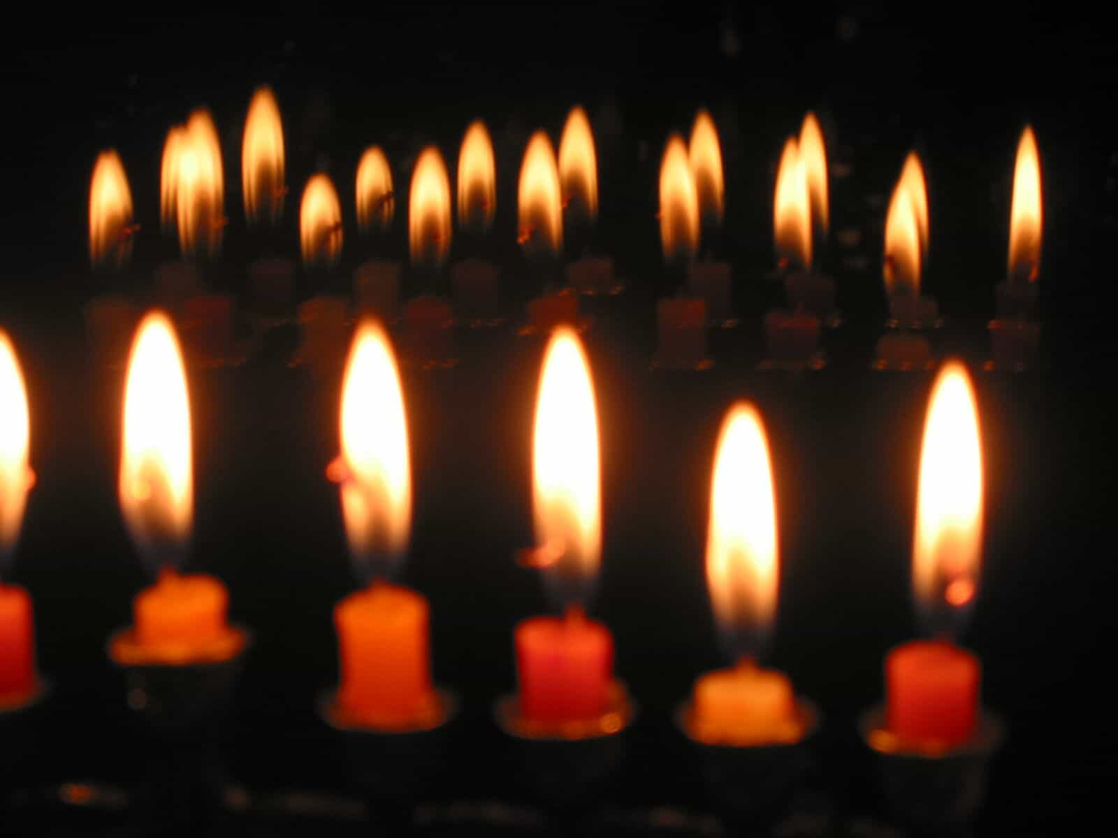A closeup of candles burning.