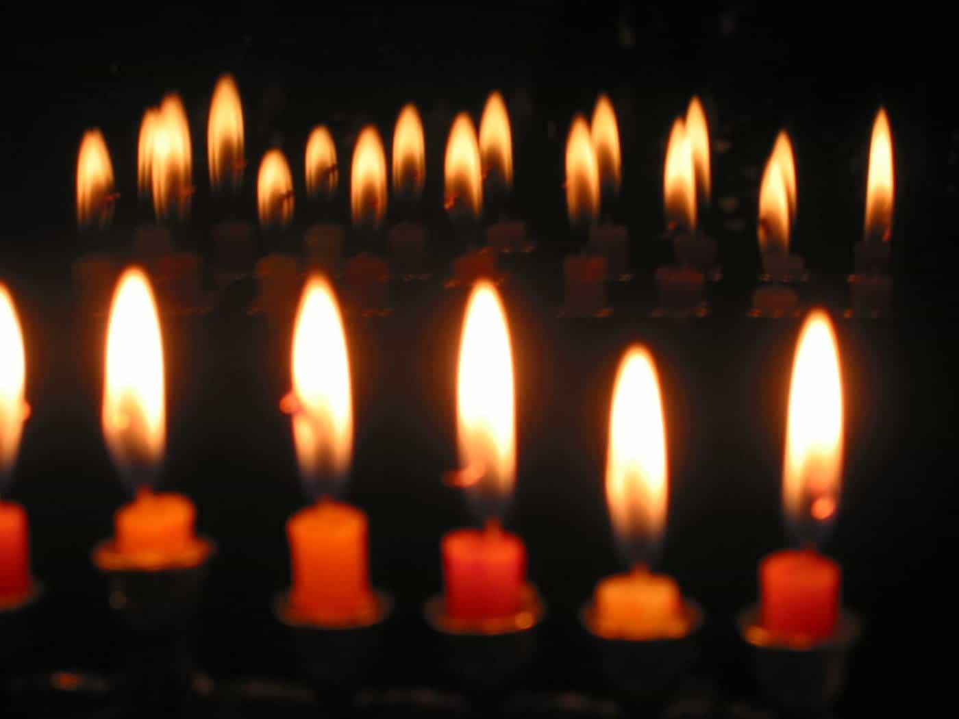A closeup of candles burning.