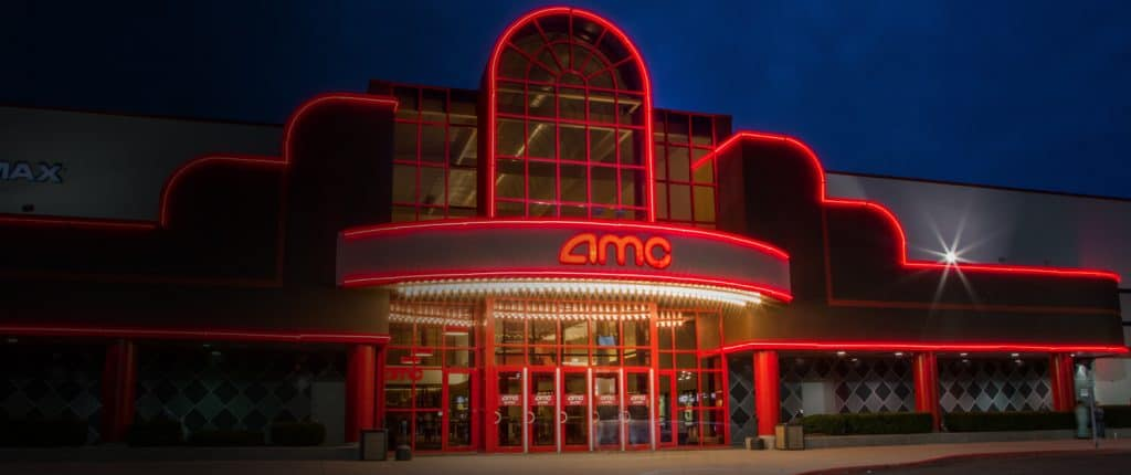 A picture of the front entrance to a AMC theater.