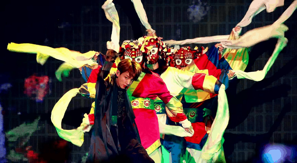 BTS performing on stage wearing traditional South Korean outfits.