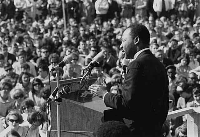 Martin Luther King Jr. making a speech in front of a crowd of people.