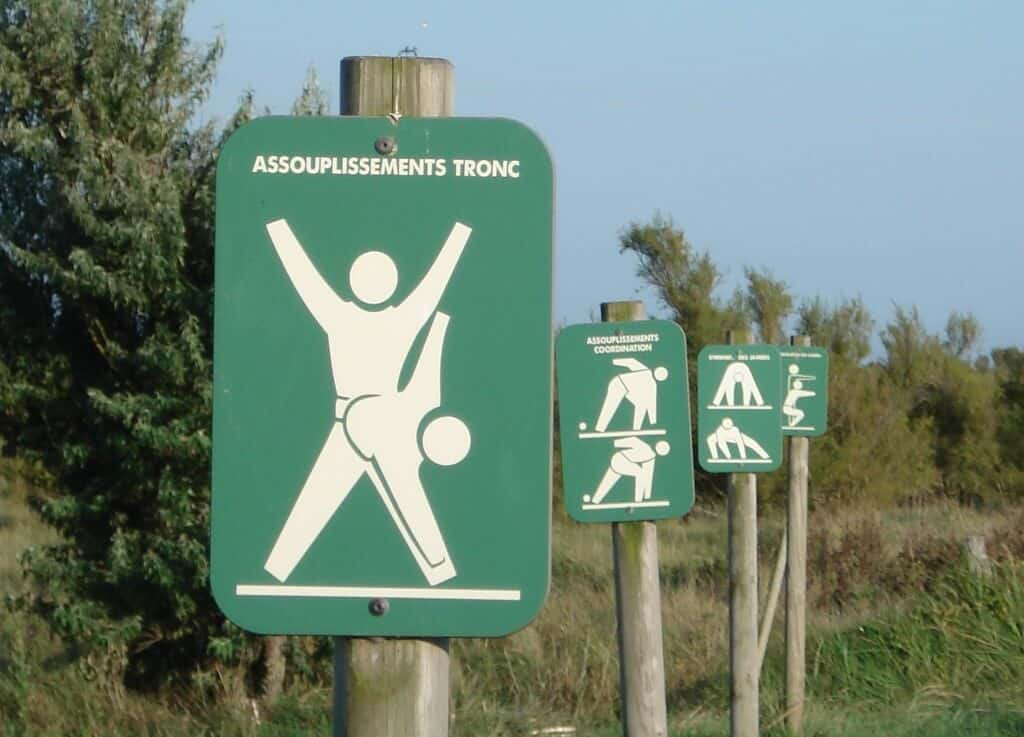 A series of signs with various exercises on them.