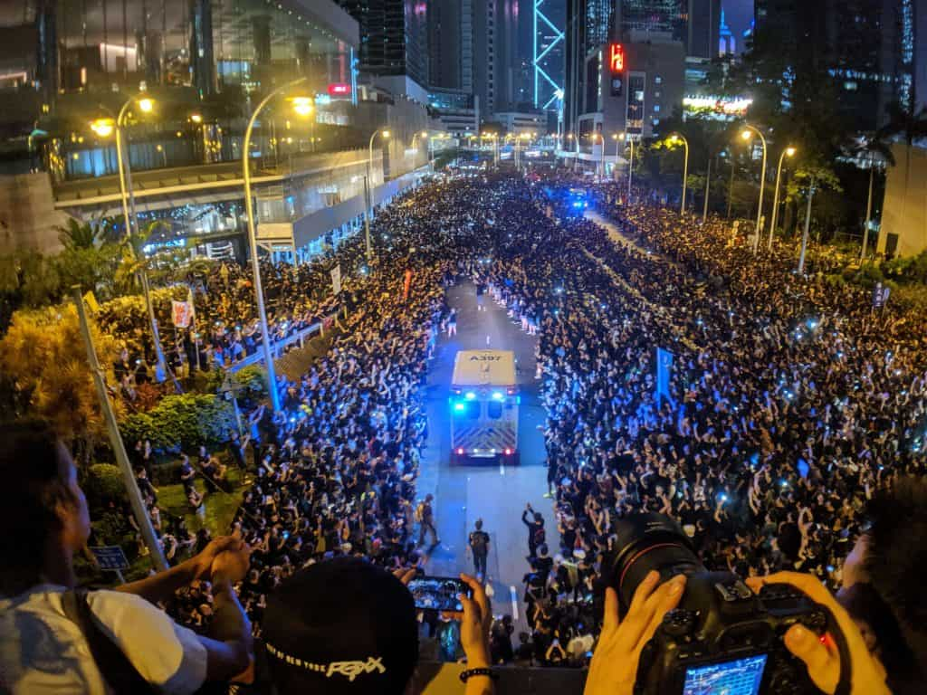 2019 Hong Kong anti-extradition law protest with an ambulance driving through a crowd of people.