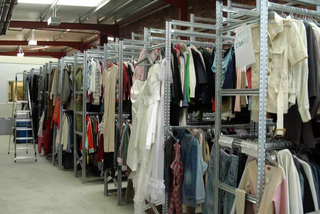 Racks of secondhand clothing.