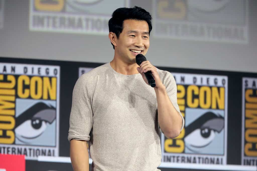 Simu Liu speaking at Comic Con San Diego.