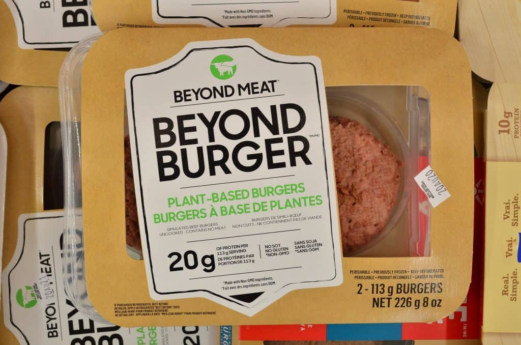 A picture of a plant based burger in packaging called 'Beyond Burger'.