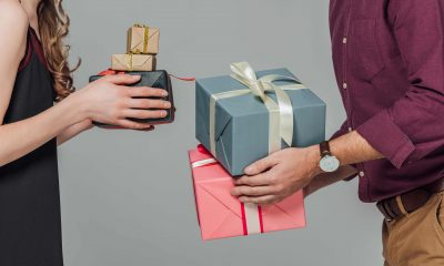 a man is giving gifts to a woman