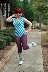 A women dressed in 80s clothing.