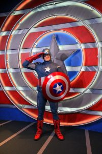 A man dressed up as Captain America.