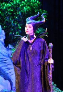 A women dressed up as Maleficent.