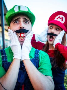 A couple dressed up as Mario and Luigi.