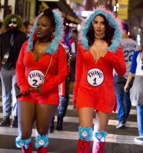 Two girls dressed up as thing 1 and thing 2 from Dr. Seuss.