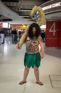 A man dressed up as Maui for Halloween.