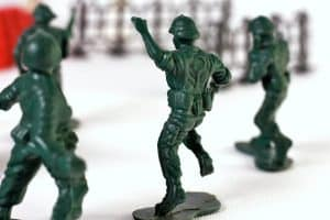 Three toy soldiers.