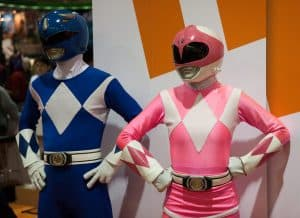 Two people dressed up as a blue and pink power ranger.