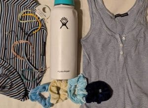 A hydroflask and various pieces of clothing.