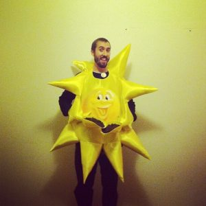 A man dressed up as the sun.