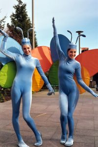 Two women dressed up as butterflies.