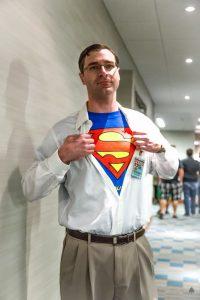 A man dressed up as Clark Kent.