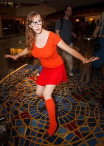 A women dress up as Velma from Scooby doo.