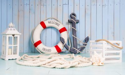 A lifebuoy next to an anchor that reads welcome aboard.